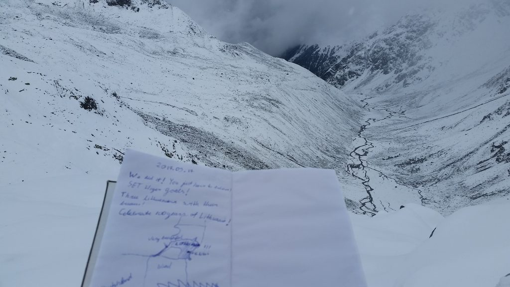 Notebook for hikers with background of Glockturm valley