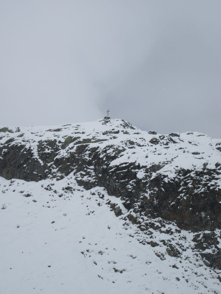 Cross on one of low level mountaintops