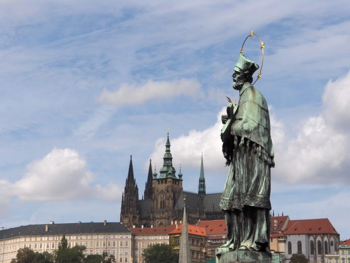 Statue in the prime plan, and Prague castle in the background, Czech Republic 2012