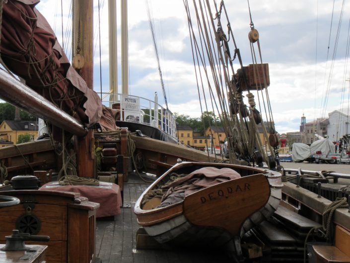 Tilted boat in the larger ship on the port of Stockholm