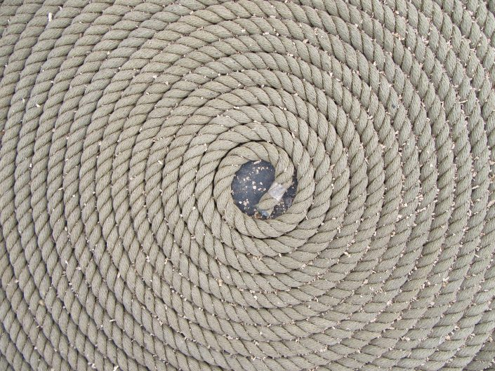 Marine rope wrapped in circle on the deck of a ship in stockholm
