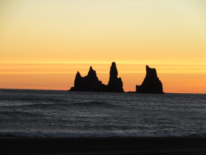 Cliffs in the sea near Vik, Iceland after the sunset