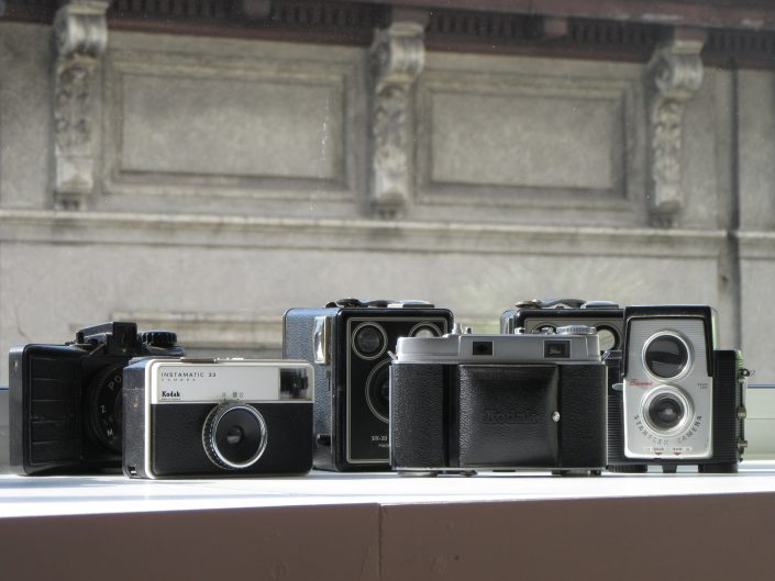 old photo cameras on window sill. Feature image for GeneralistLab Galleries page. Wonderful interior design detail.