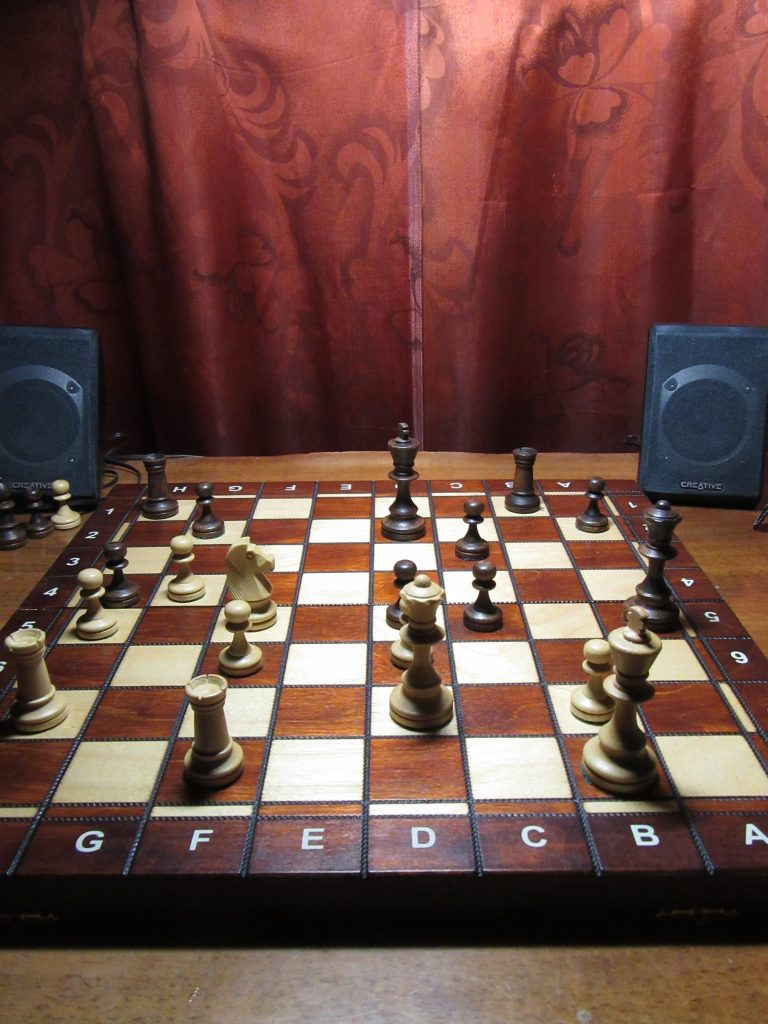 chess board with figures on the table. A way to spend a month without internet