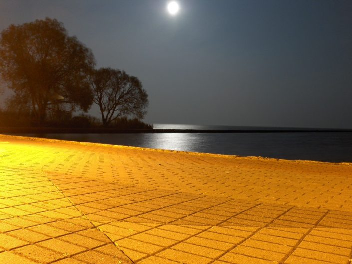 Full moon perfect reflection on Kursiu Marios at Lithuania and evening lights in Nida.