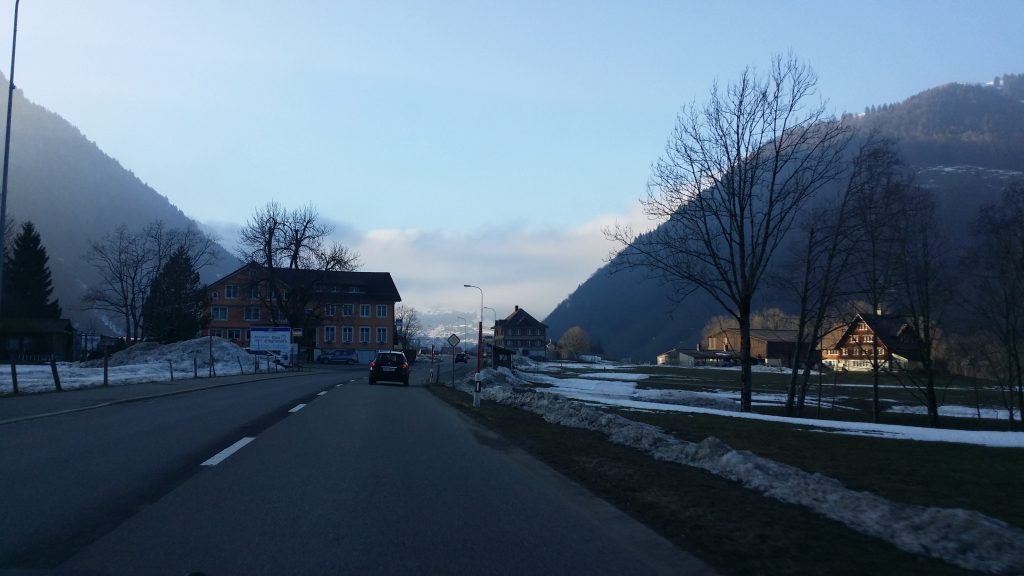 One road leading to Nasslau from Vaduz, between the mountains, early spring