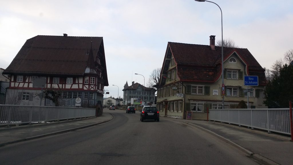 New st. Johan city entrance photo from car. Cute small city of Switzerland