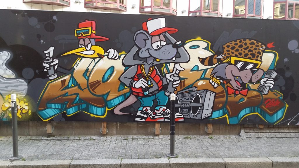 Street art: graffiti and Animated characters in street like fashion