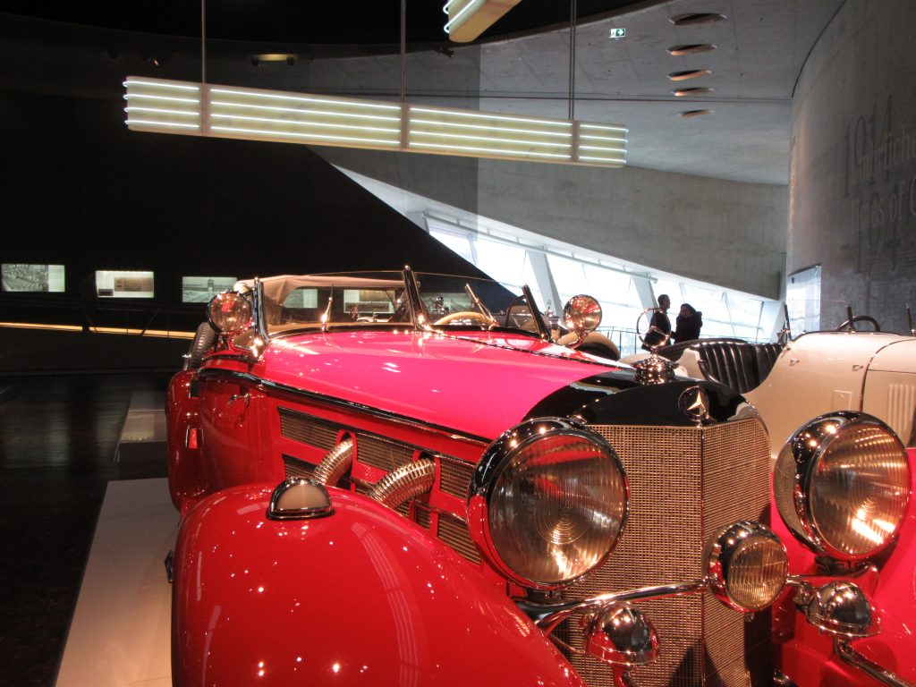 Impressive red car with loooong hood in Mercedes-Benz Museum