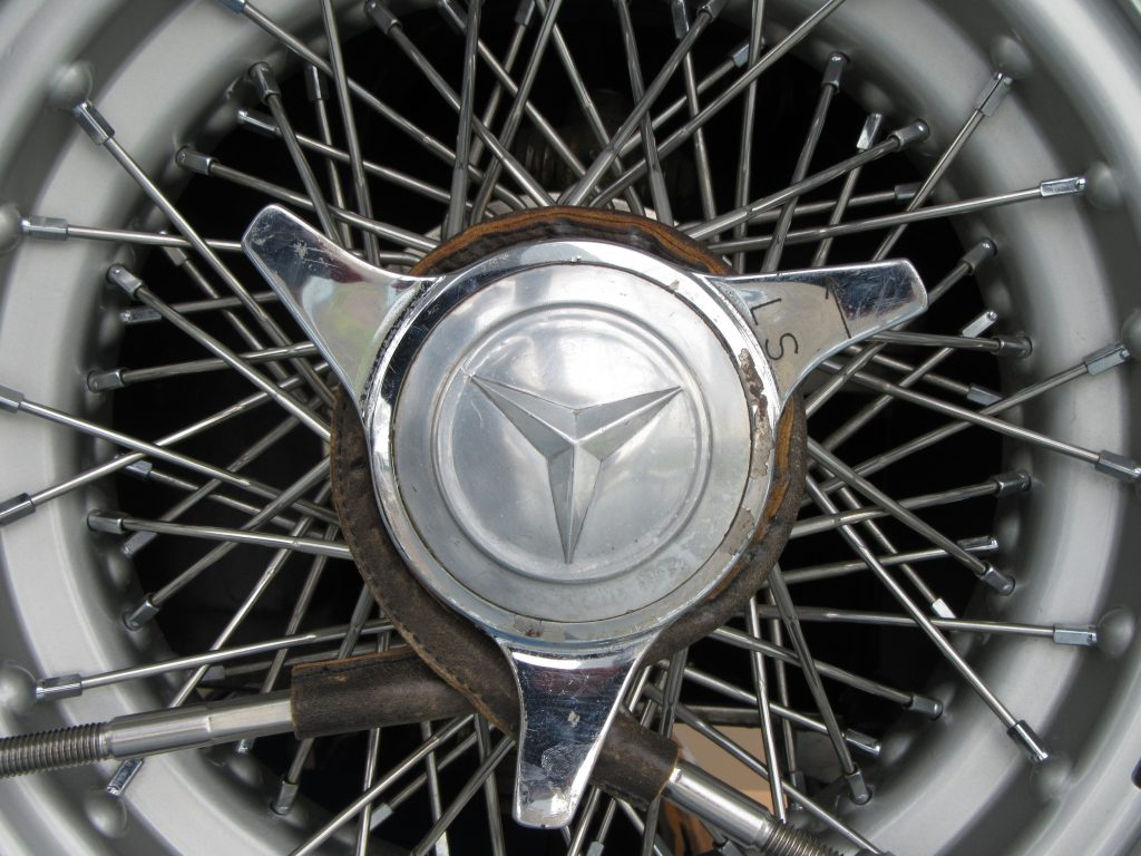Spikes and Mercedes-Benz logo in the middle of macro shot of rim