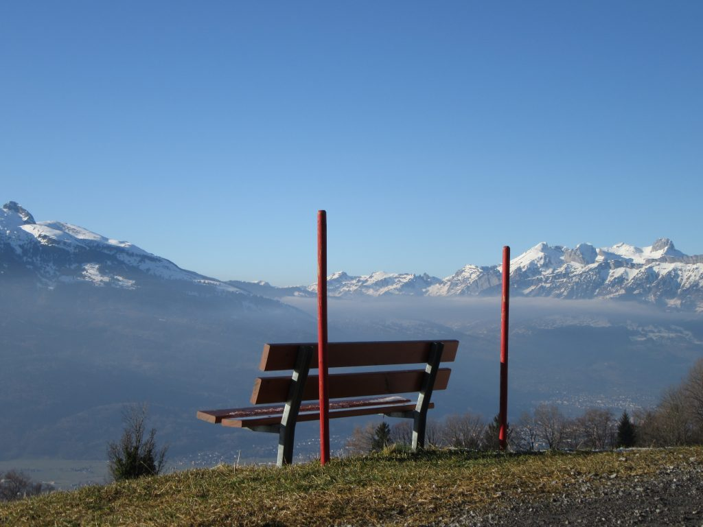 Same bench from different angle to enjoy Vaduz from the top with snowy Alps surrounding view