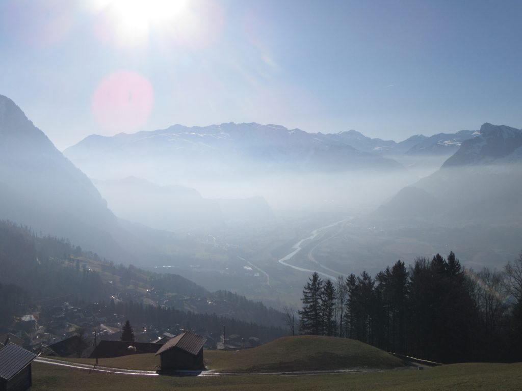 Southern side of Liechtenstein from the top, sunny, foggy panoramic view