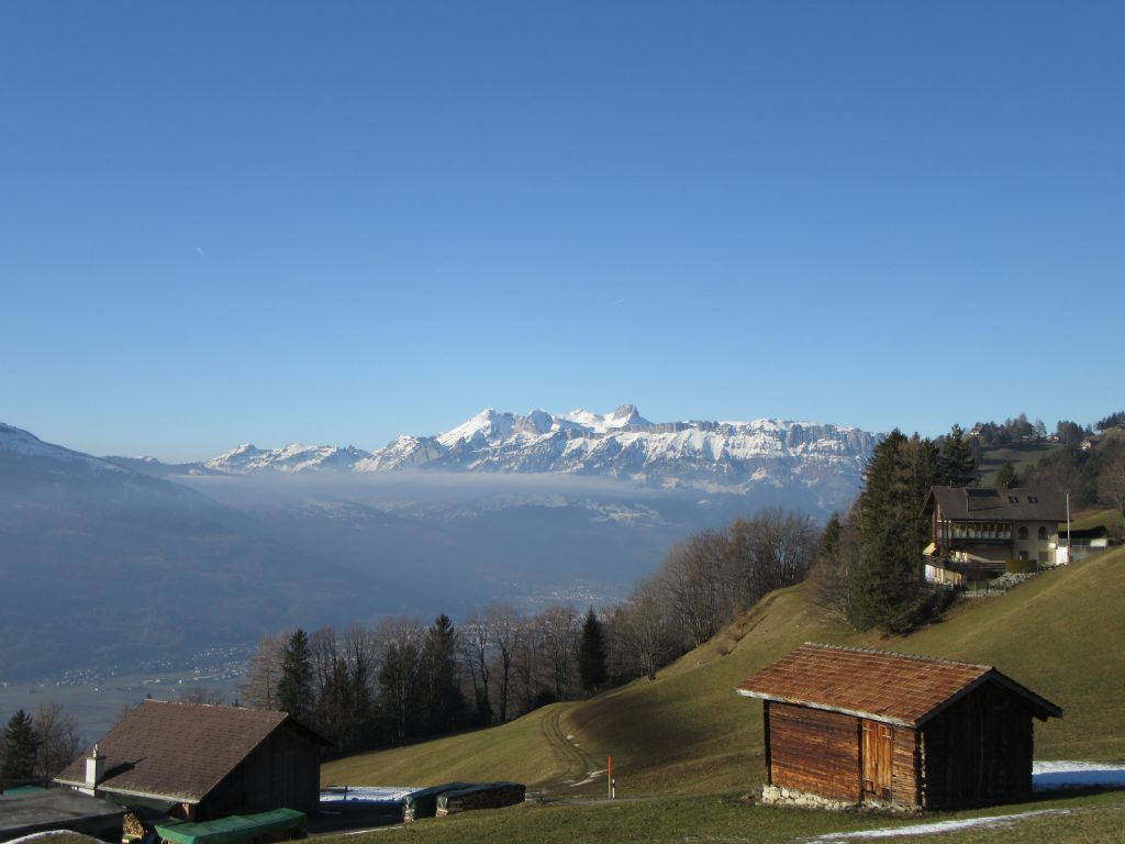 Snowy Alps of Liechtenstein in early spring and surrounding mountain houses