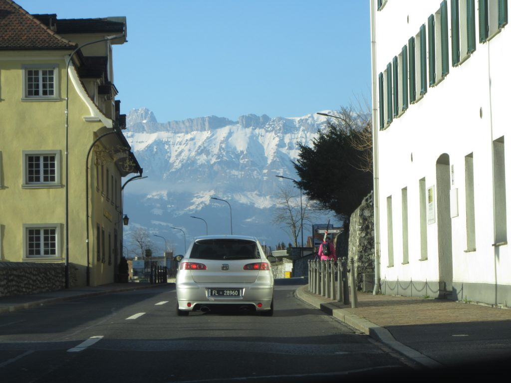 A street of Vaduz with a background of 50% sky and 50% snowy mountains