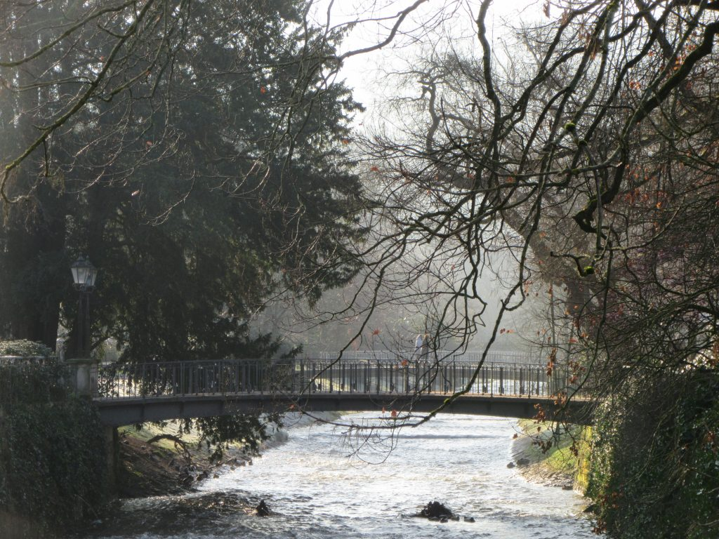 Oos river and a bridge in late sunny winter morning at Baden-Baden