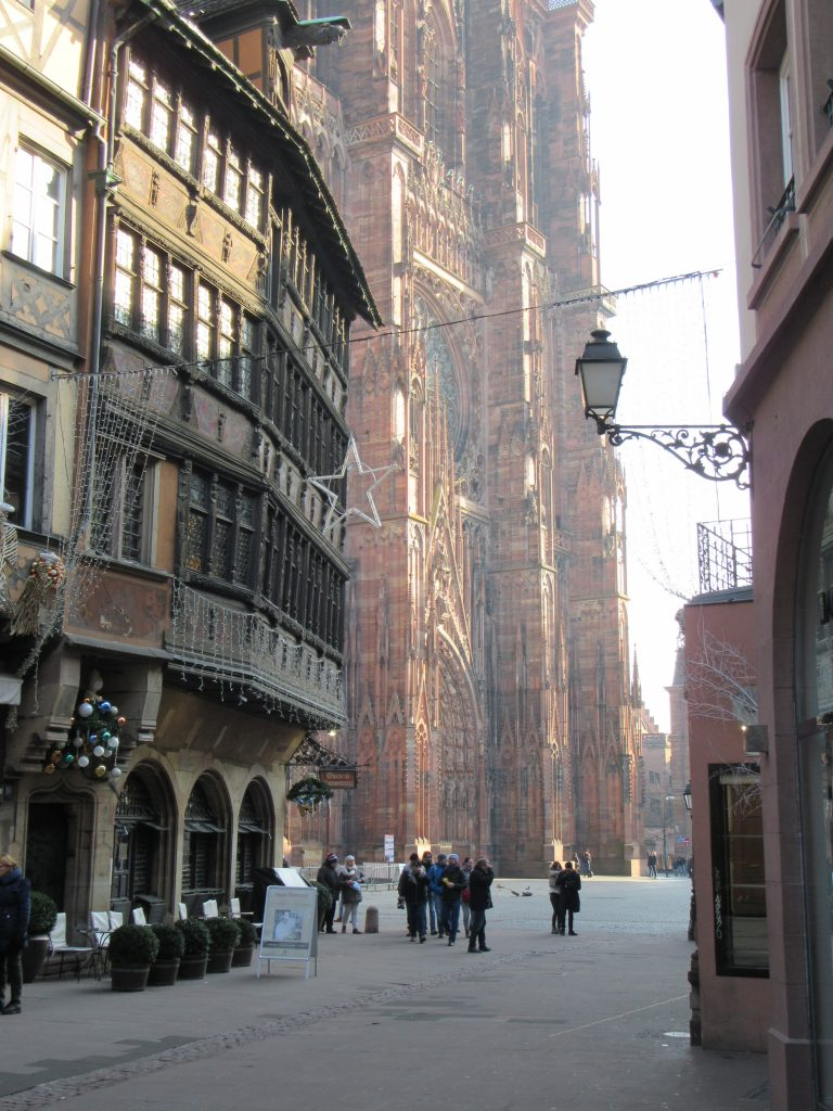 Like 1/6 of Strasbourg Cathedral de Notre-Dame visible at the shot, in comparison to closer standing casual building to emphasize the gigantic size of Cathedral