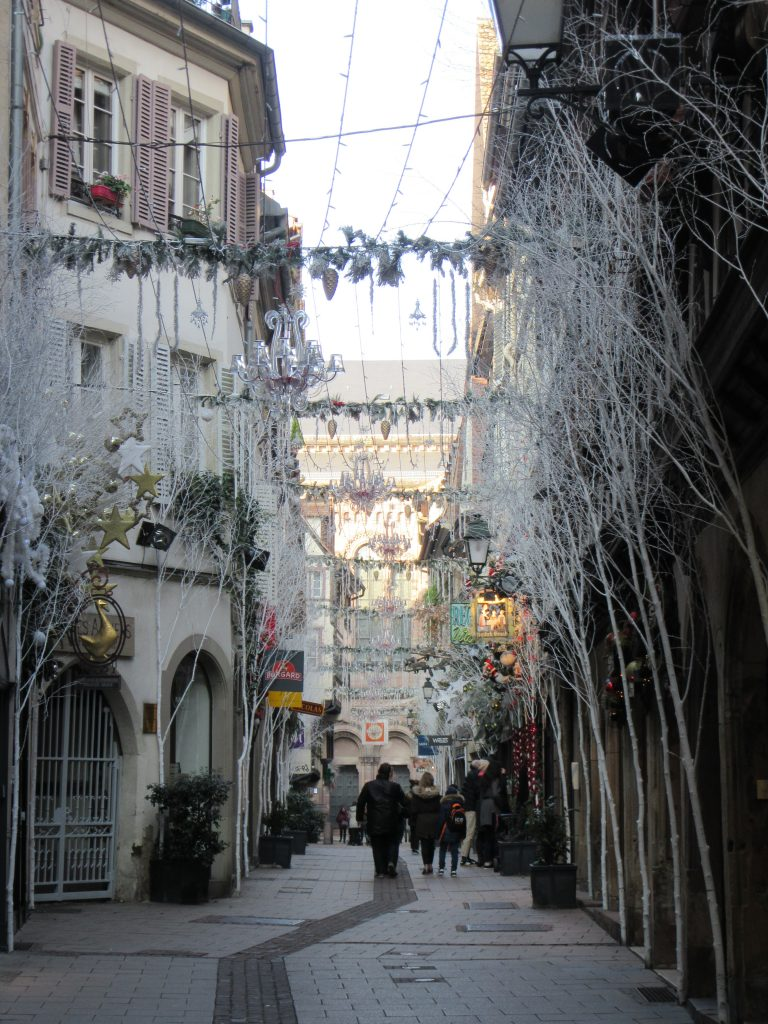 White Christmas decorations above the central street of Strasbourg, France
