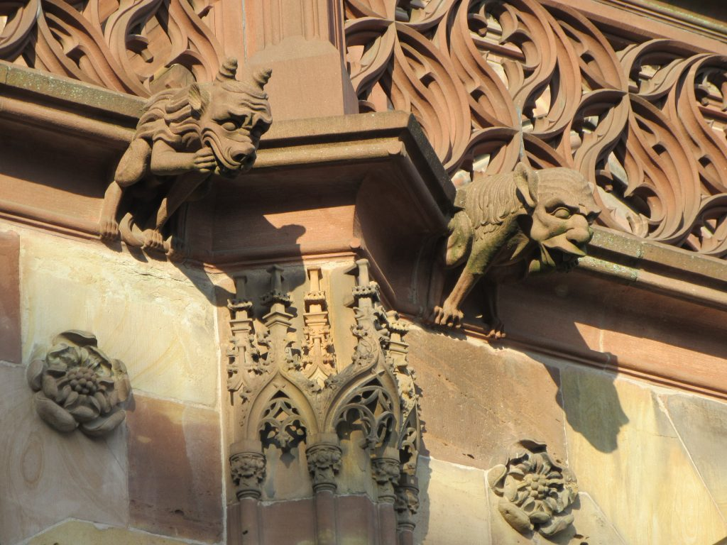 Architecture details: Two little devils of stone in Strasbourg Cathedral de Notre-Dame