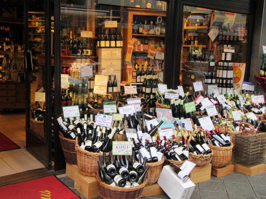 Enormous amount of wine bottles at the wine shop near the street at Mannheim