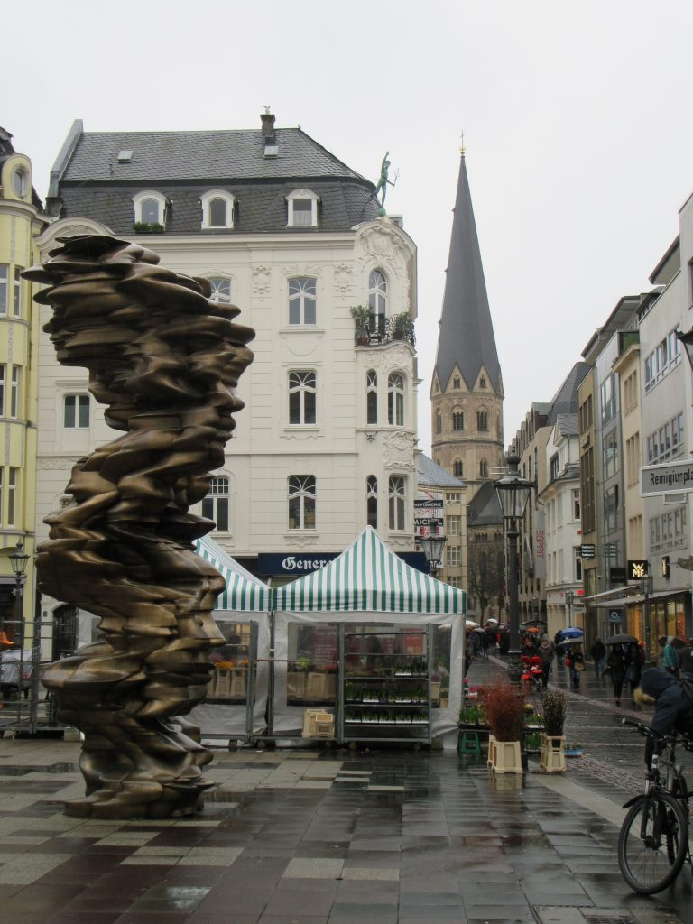 Bonn city center: stone-like sculpture, church and mini local market