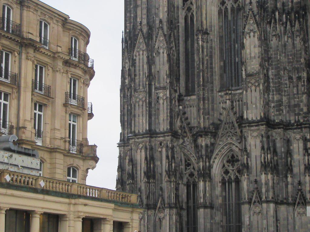 Gothic vs casual architecture in main square of Cologne (Köln)