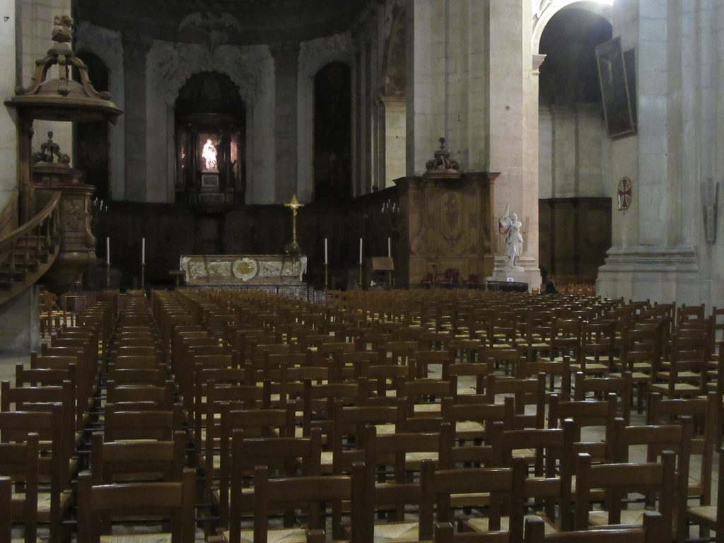 Rows of empty chairs at small church in Nancy, France