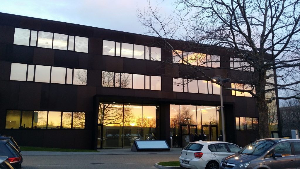 Training center building with sunrise reflections in huge windows