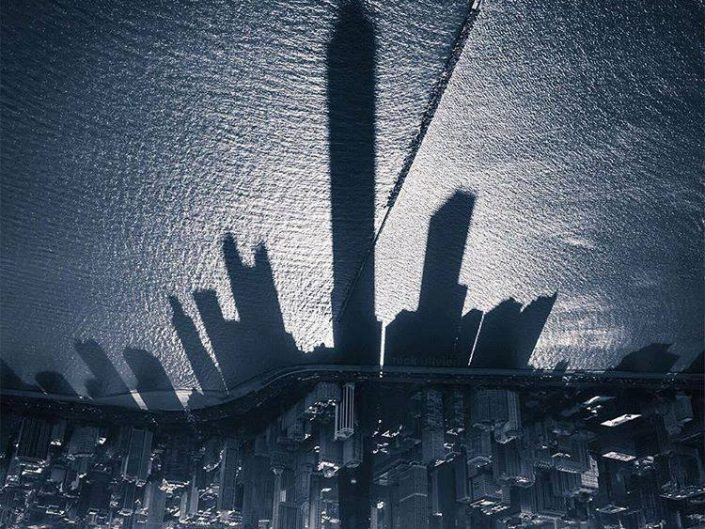 Upside down photography by Nick Ulvieri of Skyscaper casting shadow on Michigan Lake, Chicago