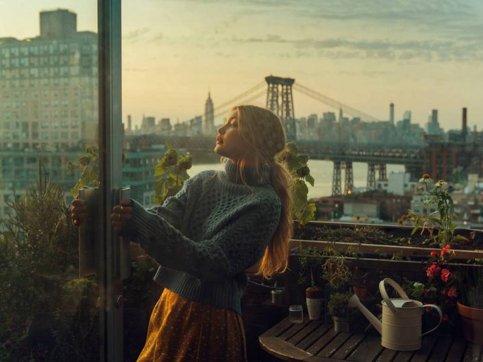 Christopher Anderson photography of woman leaning at the door in the balcony, New York