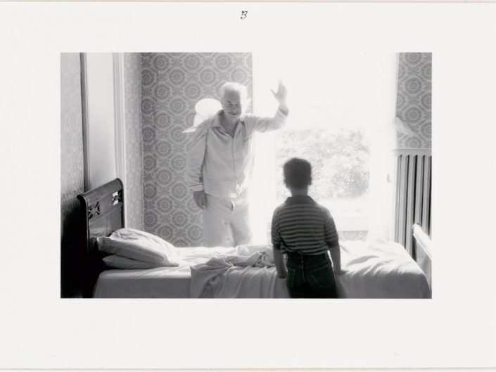 Duane Michals - Grandpa Goes to Heaven, 1989. BW photo of grandpa waiving good bye to his grandson over the bed.
