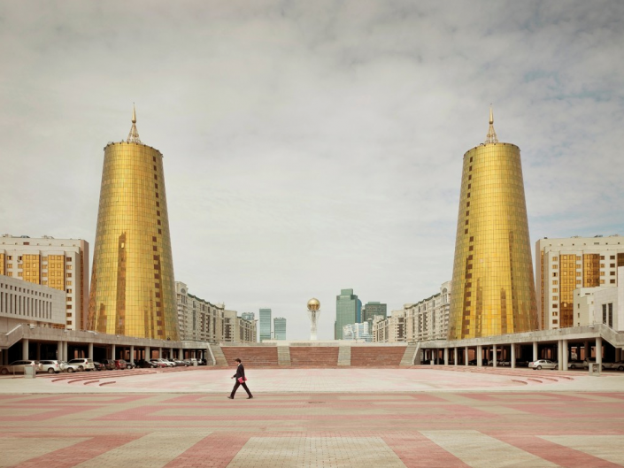 Frank Herfort Ministry Buildings. Astana, Kazakhstan, 2012 Square and a man crossing. Soviet Union architecture