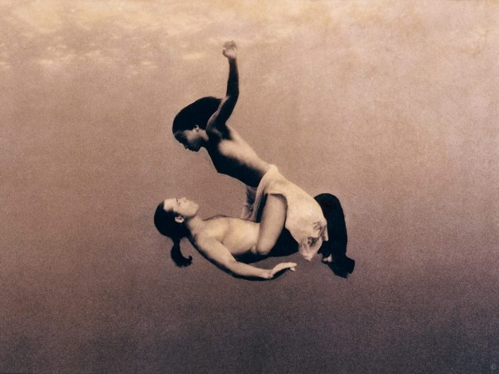Scene from Ashes and Snow by Gregory Colbert - underwater dance of man and a girl