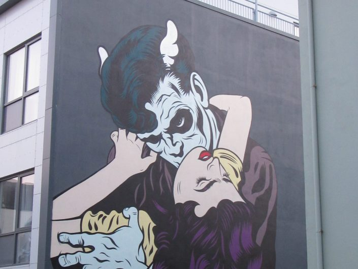 Street Art Painting of Vampire sucking a neck of a lady in Reykjavik