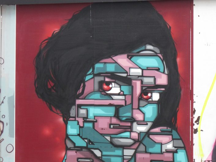 Street Art Painting of Woman's Face in Block fashion in Brussels, Belgium