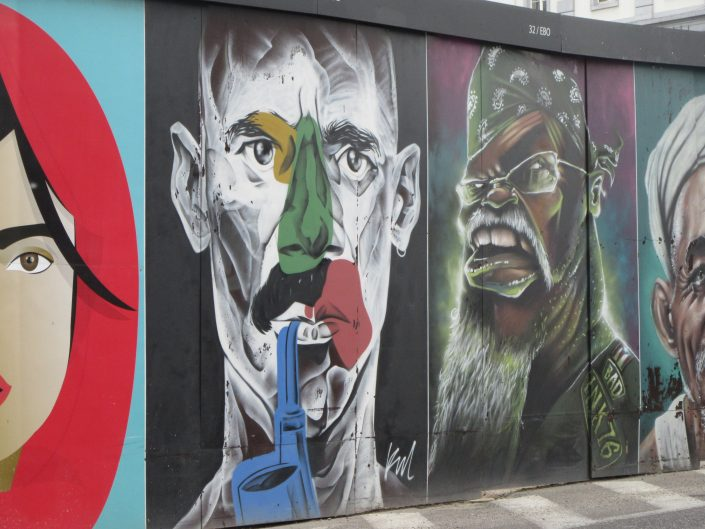two artistically painted faces on the wall of Brussels, Belgium