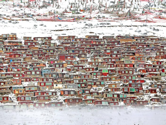 Luo Pinxi photo of snowy village and monks passing by.