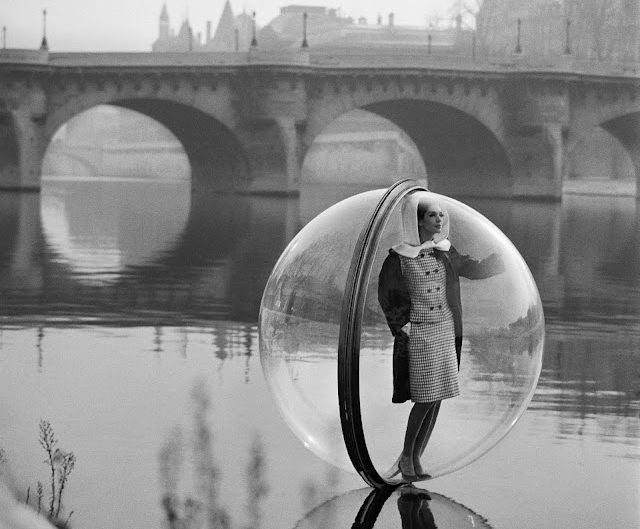 Black and white photo of model in a glass bubble on Seine River in France (1963)