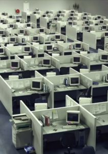Array of cubicles in traditional work in grey, monotonic mood