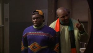 Yul is pumping up Junior in front of a bar bathroom mirror. Screenshot from Cool runnings