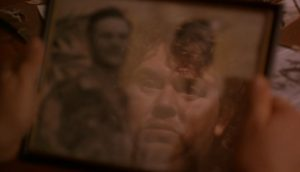 Irv (John Candy) reflection in a picture