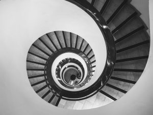 black and white photo of Spiral Stairs from the top. Metaphor for negative spiral loop I was at Vipassana day 6-7.