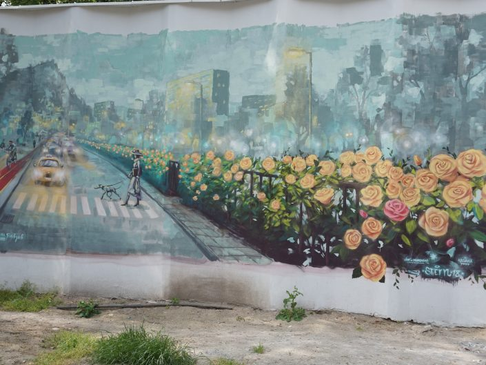 Street art painting in Plovdiv, Bulgaria depicting street scene with flowers