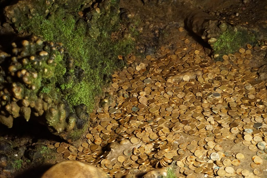 Coins in the light, Some cave in Bulgaria