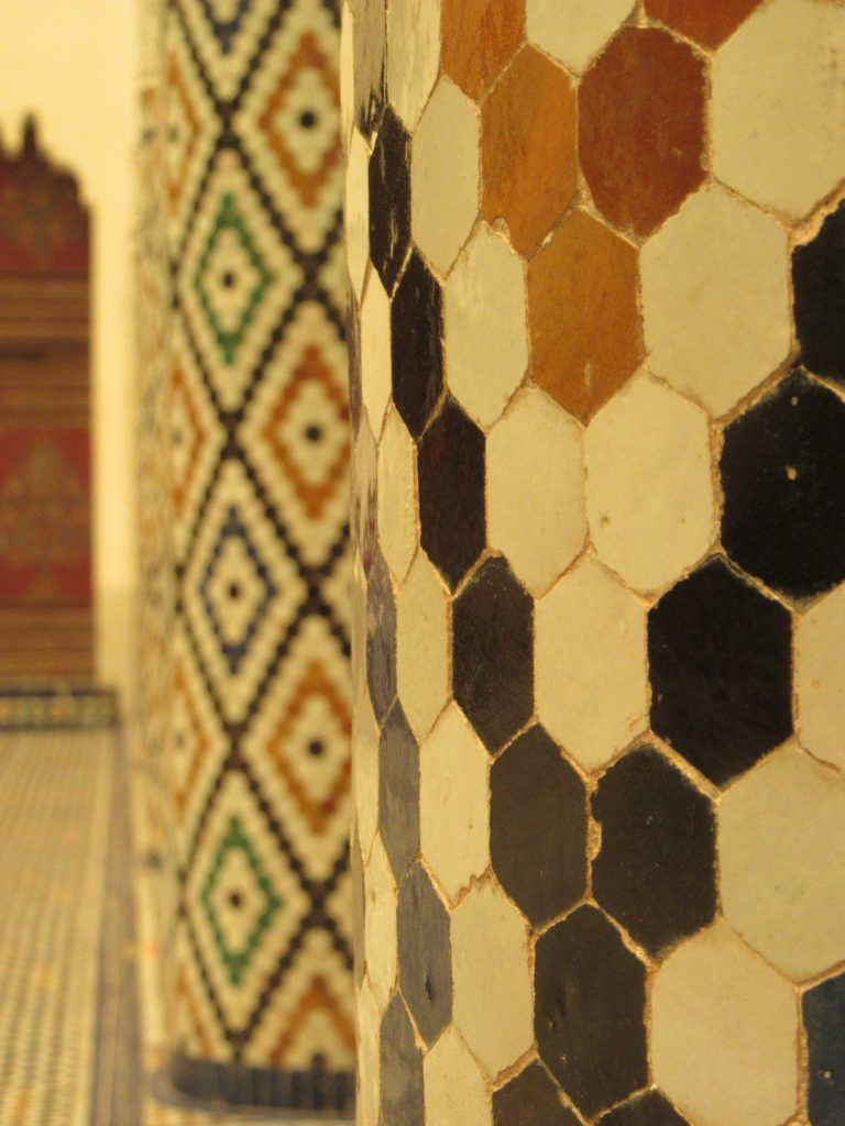 Pillars of little colorful tiles at Museum of Marrakesh