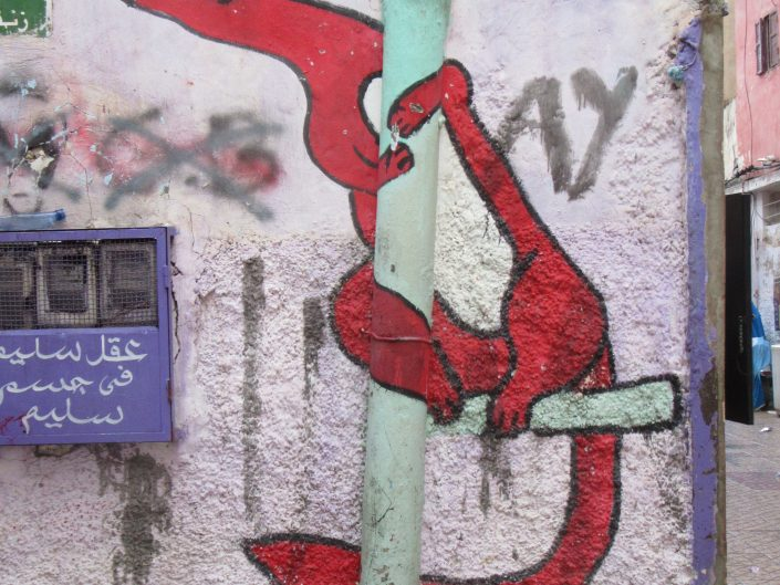 Street art paining of fox hugging a real pipe