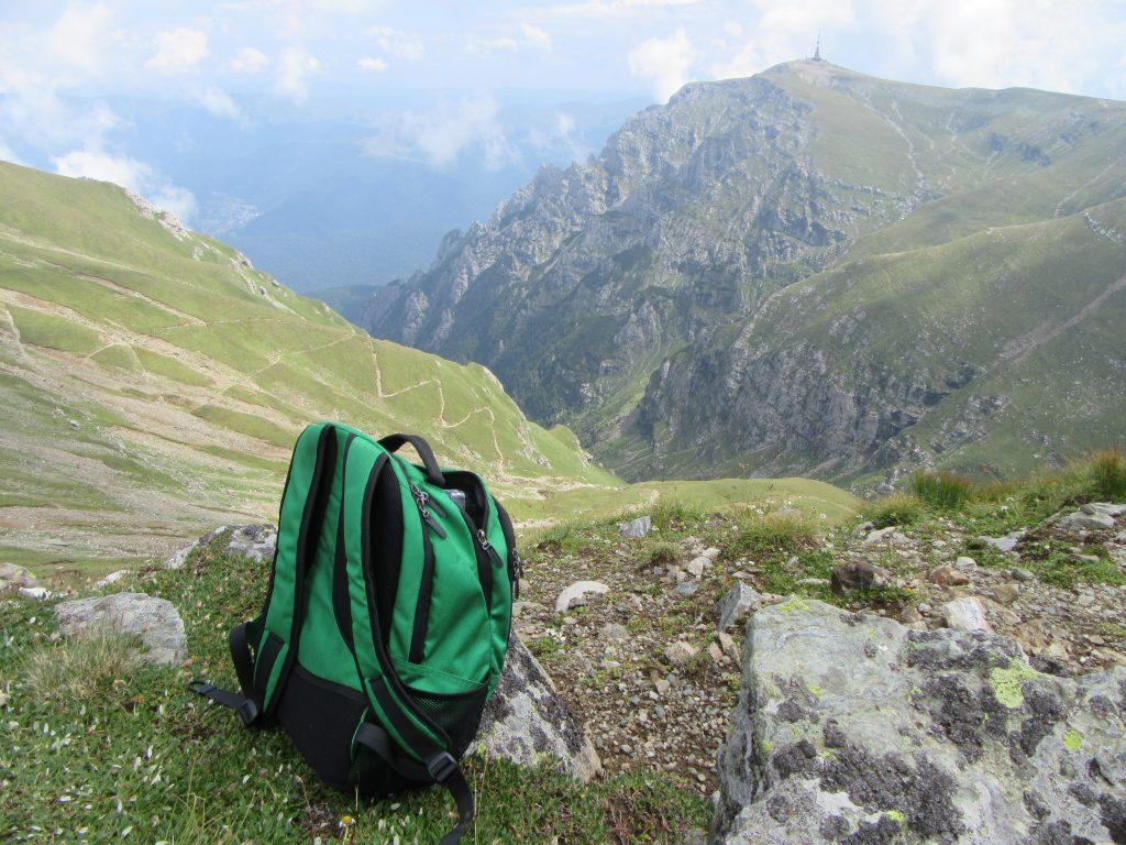 A bag and a mountain pass near Omu Peak in Bucegi Natural Park Romania