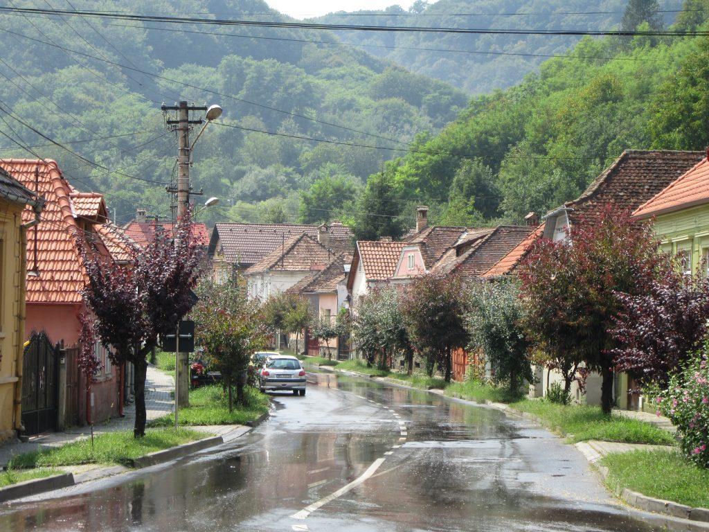 Sighisoara street after the rain in the sun, Romania