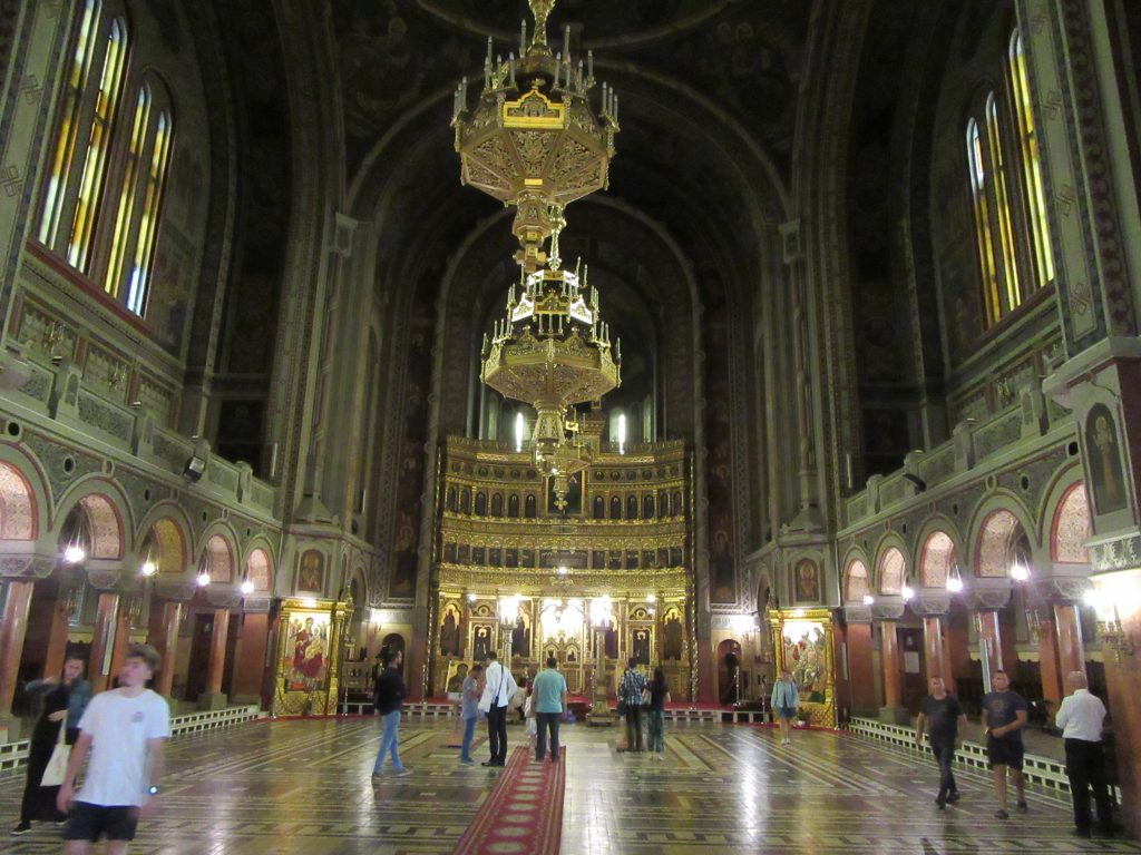 Inside Orthodox Cathedral in Timisoara Road Trip to Romania. No benches to sit on