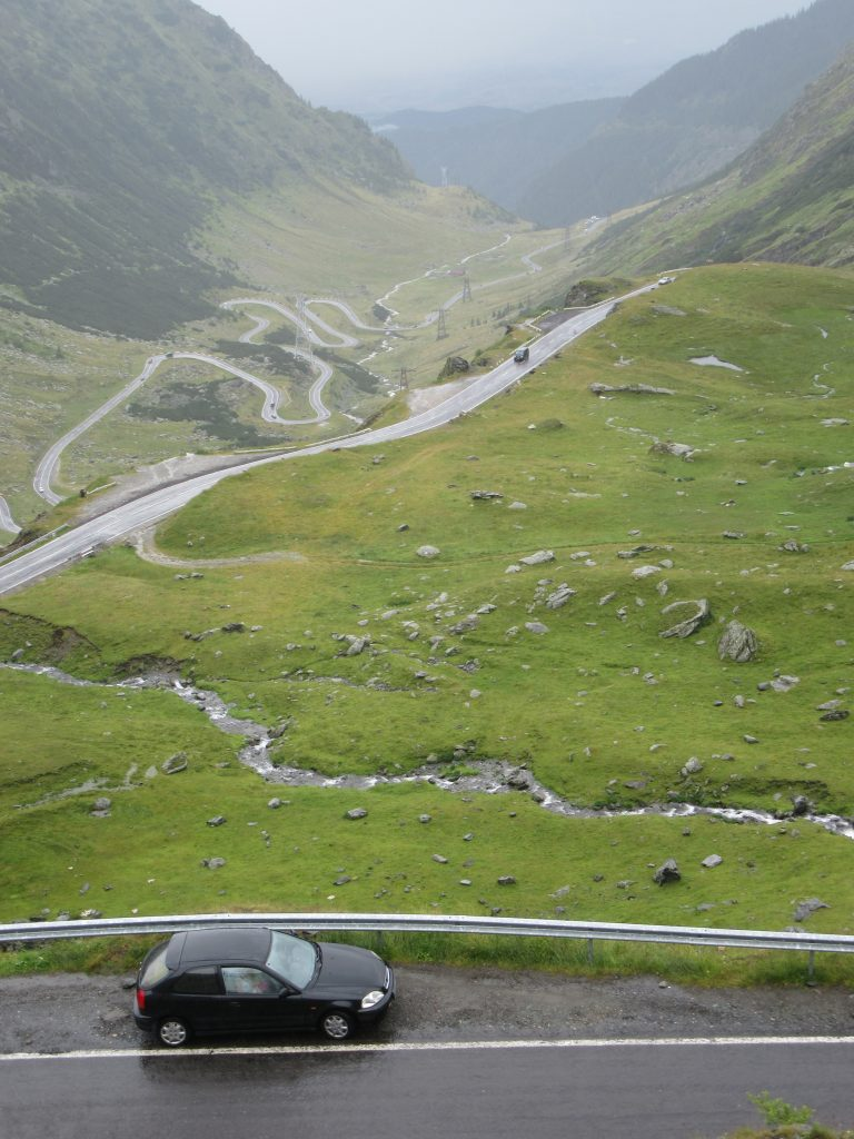 Epic Transfagarasan Scenic Road in Romania and Honda Civic in Rainy Day. Road Trip to Romania