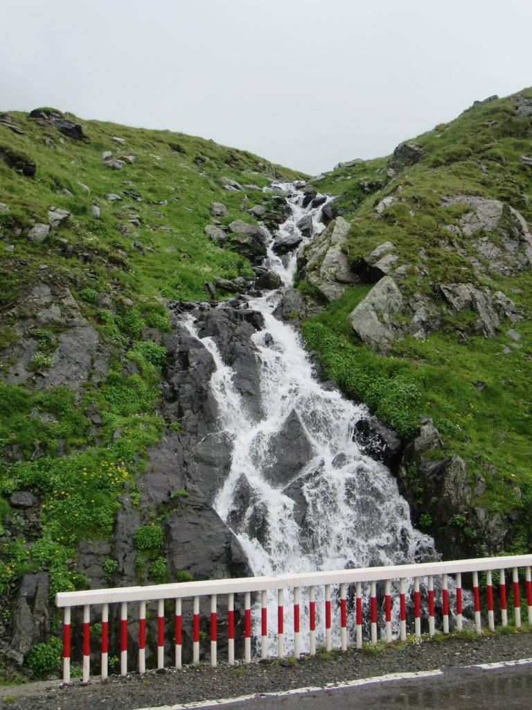 Mini waterfall on Epic Transfagarasan Scenic Road in Romania